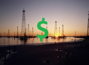 oil-derricks-with-dollar-sign